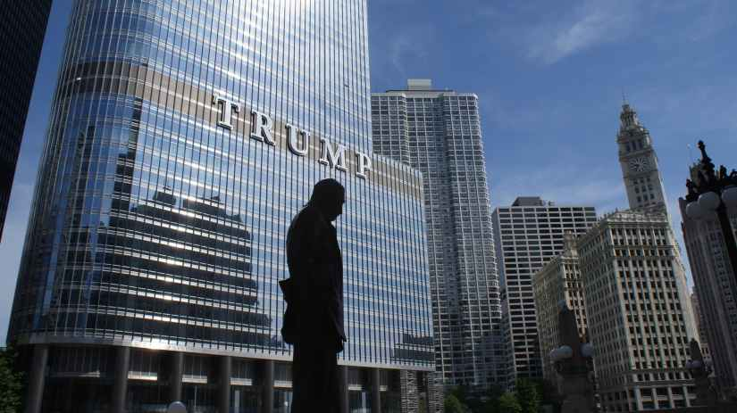 silhouette of statue near trump building at daytime